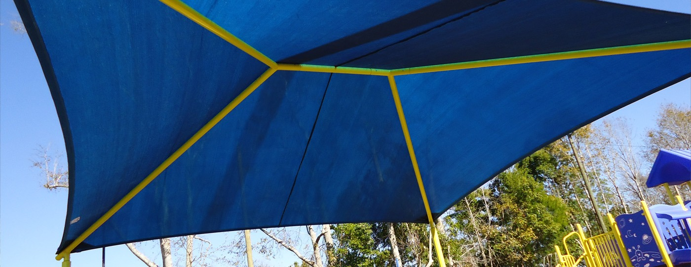 Blue hip and ridge shade playground shade structure.