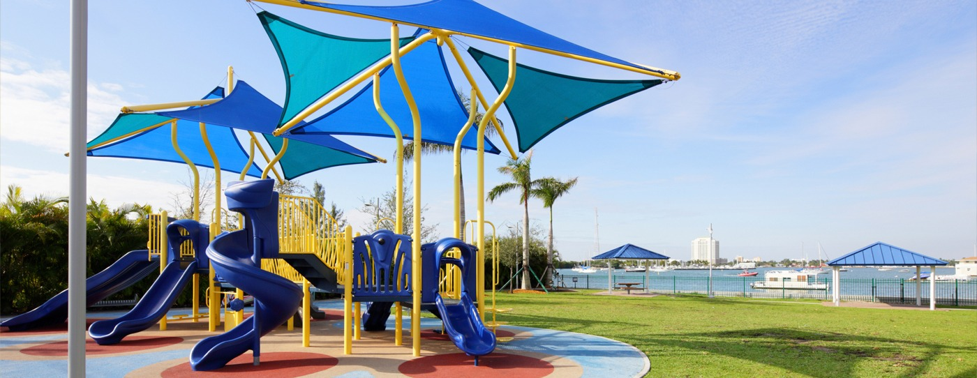 Beautiful commercial playground with integrated shade structures and poured in place rubber safety surfacing.