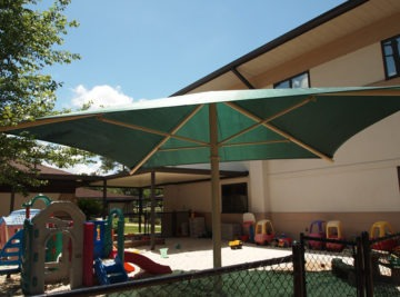 Florida umbrella shade structure installs