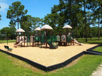 Commercial playground with climbers and site amenities