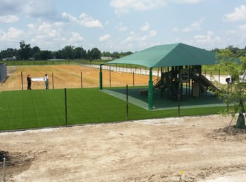 Louisiana playground, shade structure and surfacing install