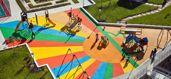 Beautiful playground with colorful poured in place rubber surfacing.