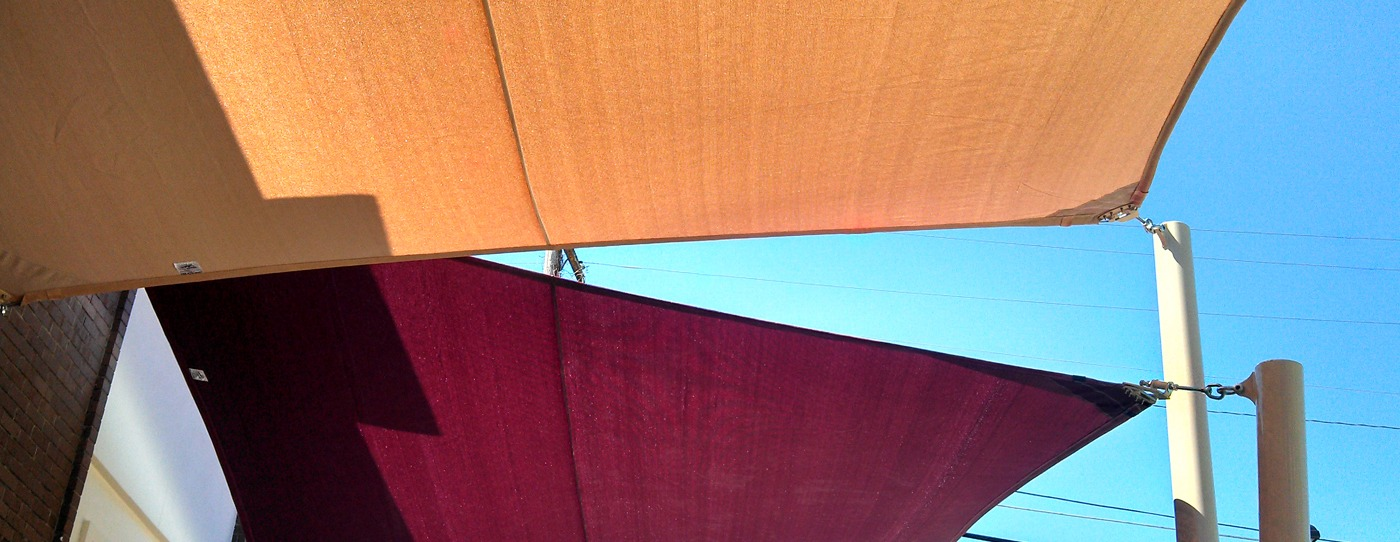 Hyperbolic sail shades provide beauty and shade to an outdoor space.