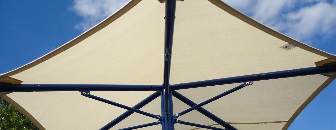 Single post umbrella shade structure.