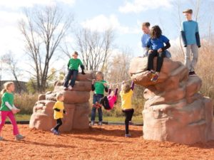 playground climbing boulder with net rockies