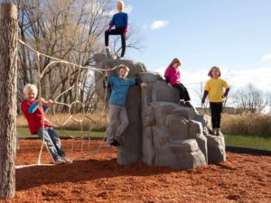 playground climbing boulder with net spider mountain