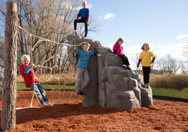 playground climbing boulder with net spider mountain