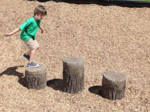 playground tree stump climbing boulder ages 2 5 years