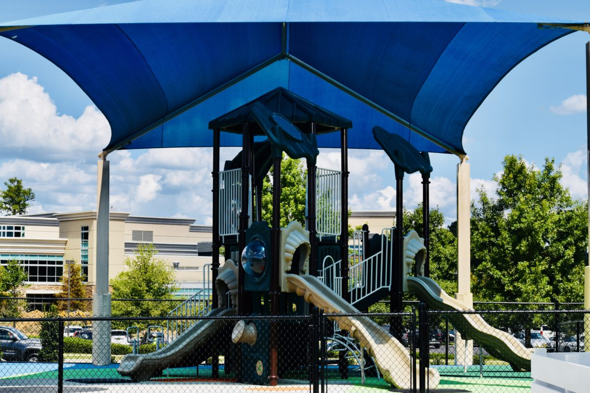 birmingham alabama daycare playground with shades and poured in place rubber safety surfacing 1