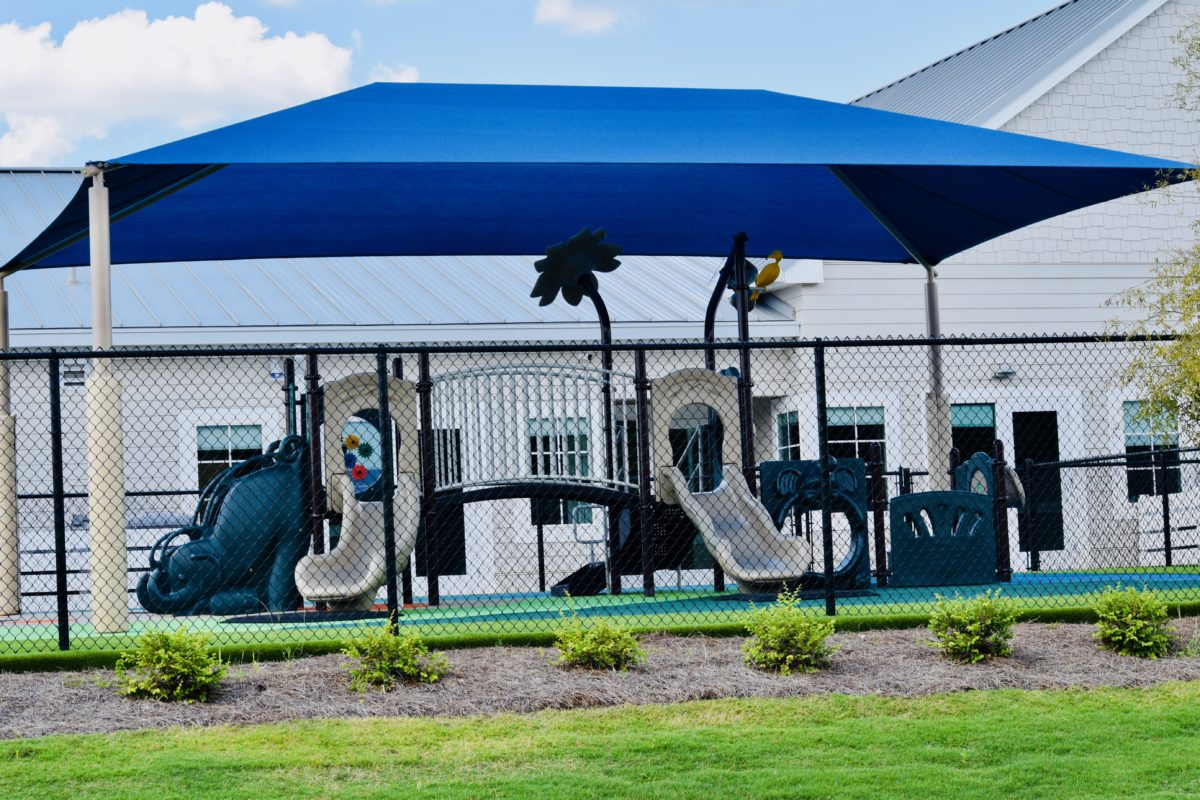 birmingham alabama daycare playground with shades and poured in place rubber safety surfacing 10