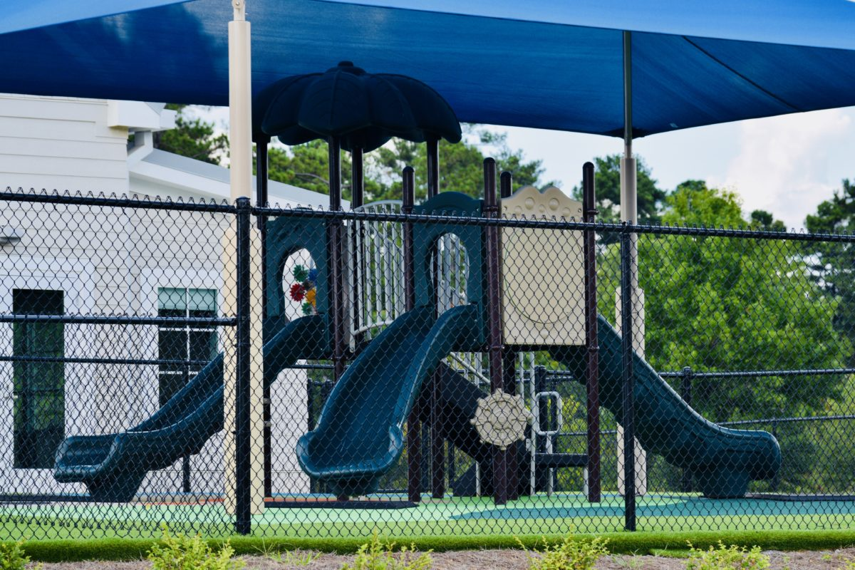 birmingham alabama daycare playground with shades and poured in place rubber safety surfacing 11