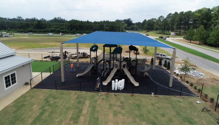 birmingham alabama daycare playground with shades and poured in place rubber safety surfacing 14