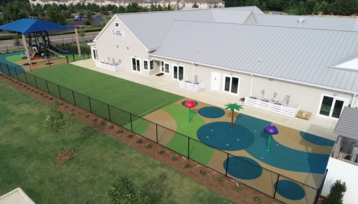 birmingham alabama daycare playground with shades and poured in place rubber safety surfacing 18