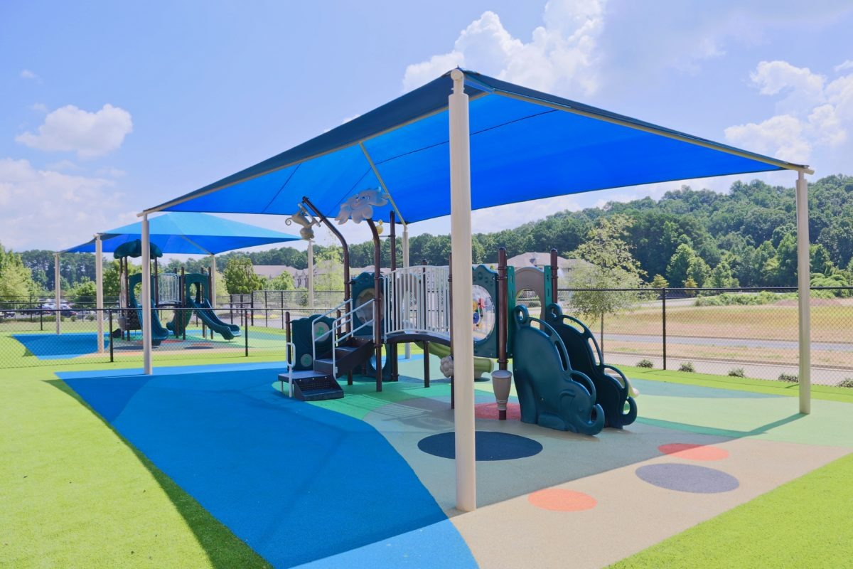 birmingham alabama daycare playground with shades and poured in place rubber safety surfacing 22
