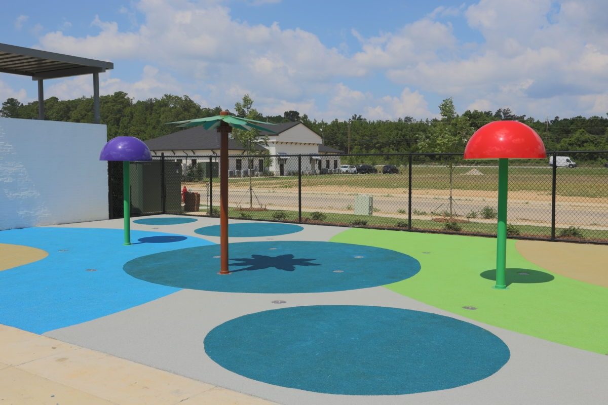 birmingham alabama daycare playground with shades and poured in place rubber safety surfacing 23