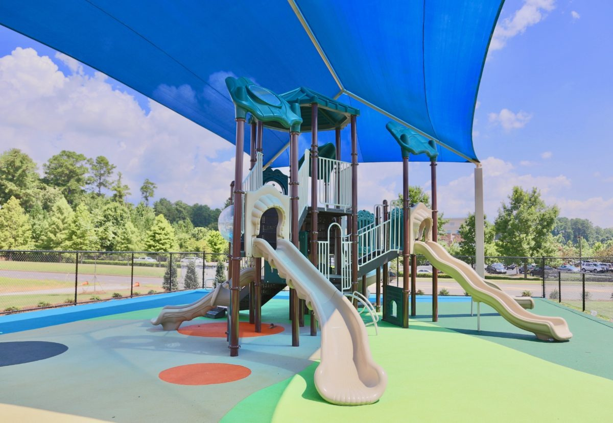 birmingham alabama daycare playground with shades and poured in place rubber safety surfacing 24
