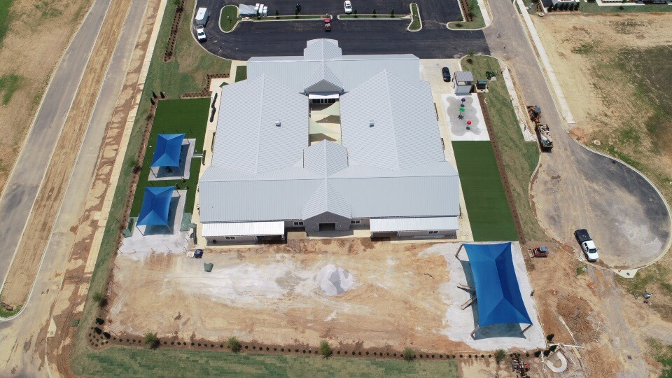 birmingham alabama daycare playground with shades and poured in place rubber safety surfacing 25