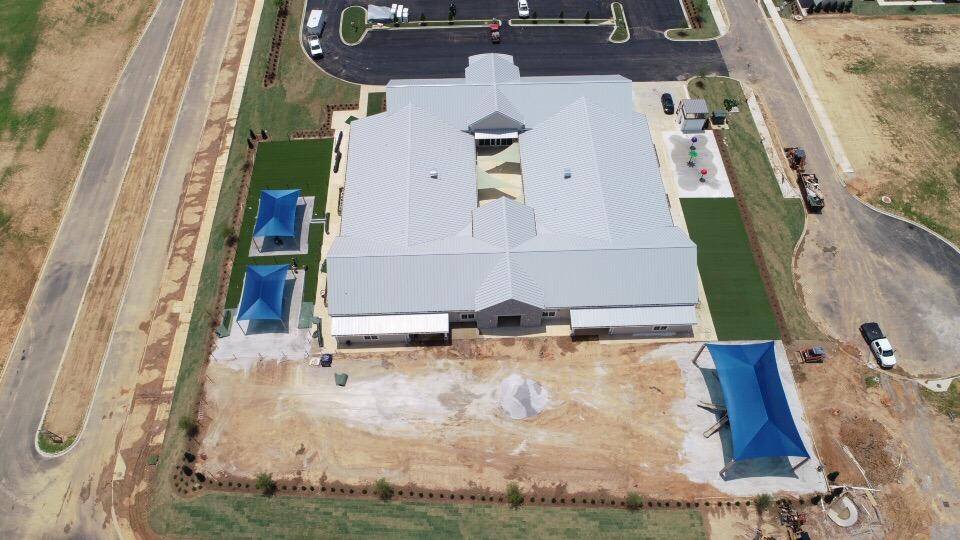 birmingham alabama daycare playground with shades and poured in place rubber safety surfacing 26
