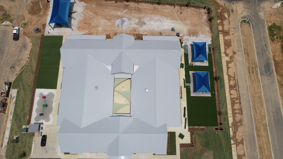 birmingham alabama daycare playground with shades and poured in place rubber safety surfacing 27
