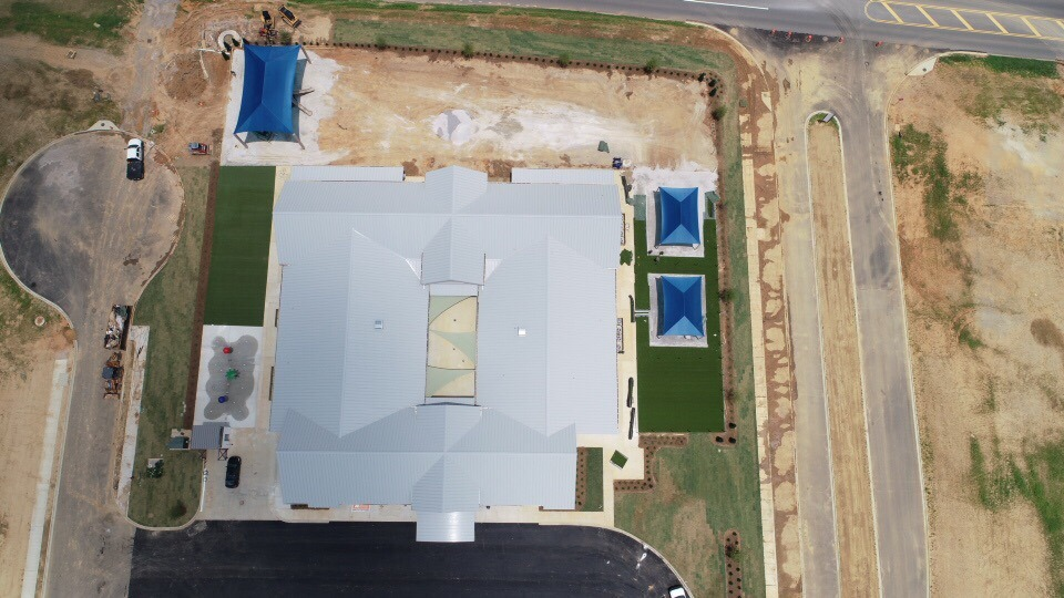 birmingham alabama daycare playground with shades and poured in place rubber safety surfacing 28