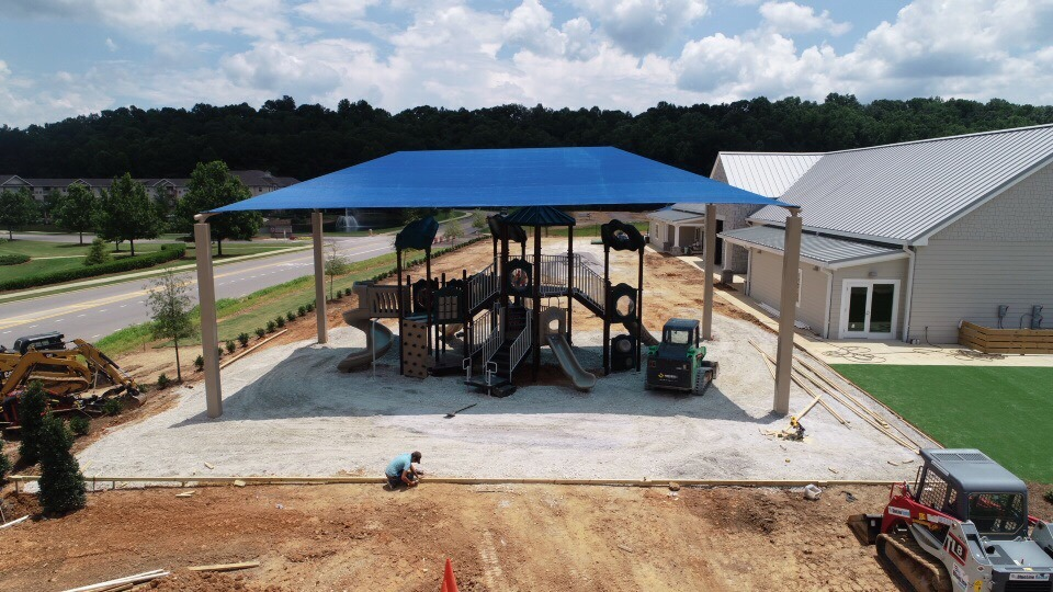 birmingham alabama daycare playground with shades and poured in place rubber safety surfacing 32