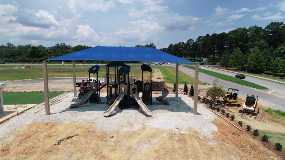 birmingham alabama daycare playground with shades and poured in place rubber safety surfacing 33