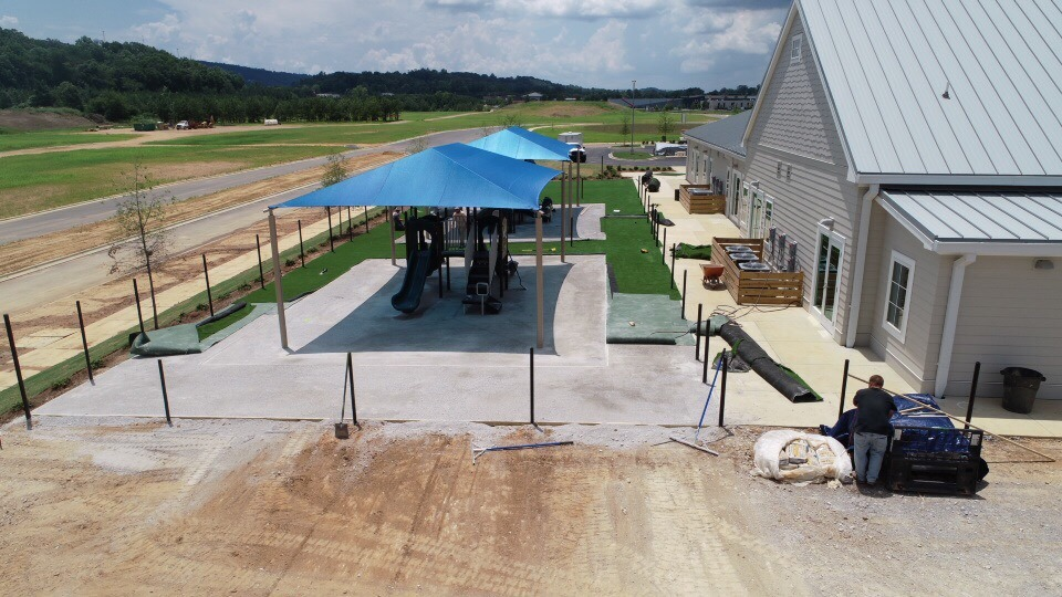 birmingham alabama daycare playground with shades and poured in place rubber safety surfacing 35