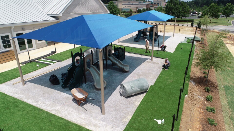 birmingham alabama daycare playground with shades and poured in place rubber safety surfacing 37