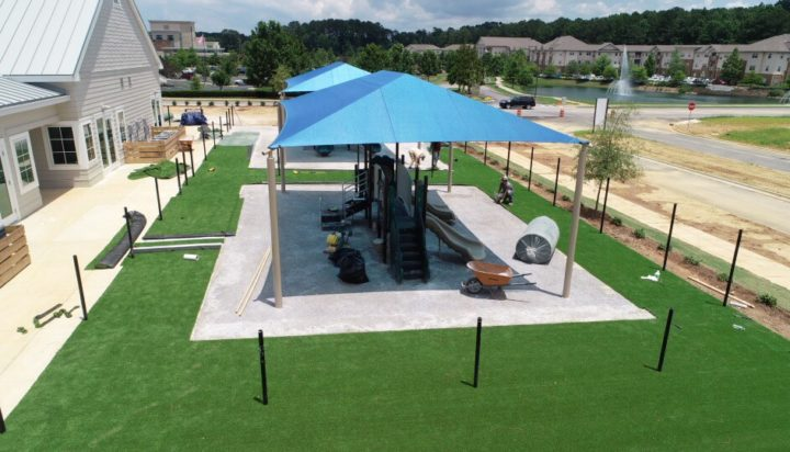 birmingham alabama daycare playground with shades and poured in place rubber safety surfacing 38