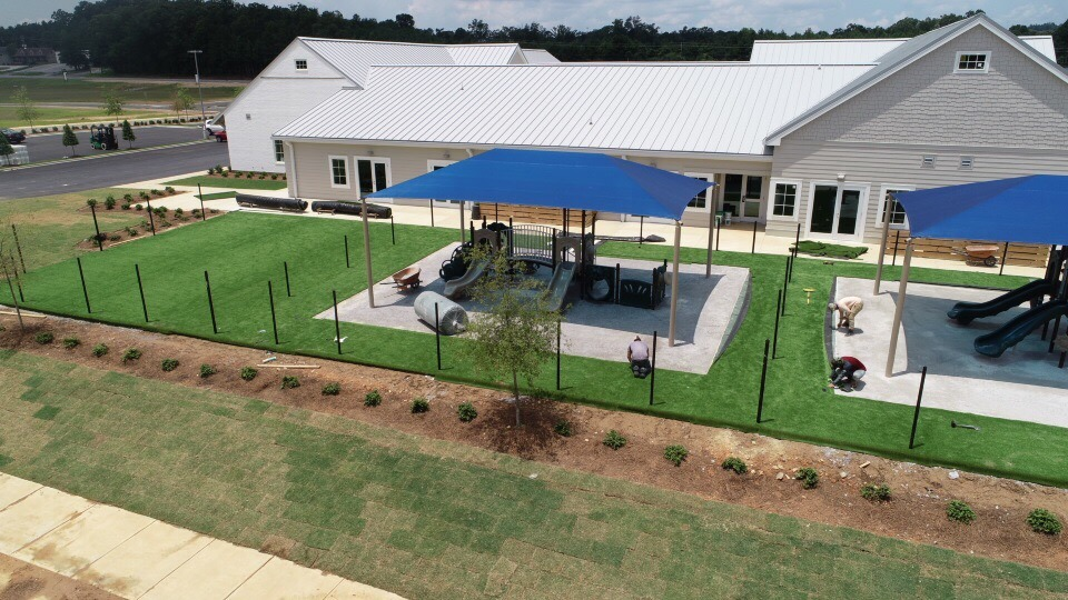 birmingham alabama daycare playground with shades and poured in place rubber safety surfacing 40