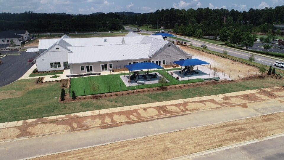 birmingham alabama daycare playground with shades and poured in place rubber safety surfacing 41