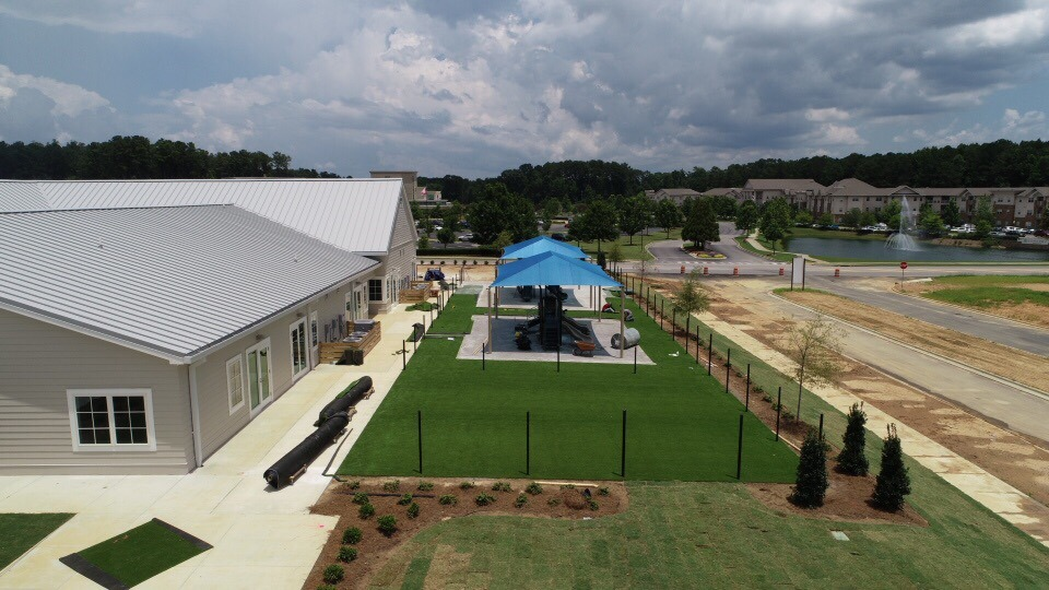 birmingham alabama daycare playground with shades and poured in place rubber safety surfacing 43