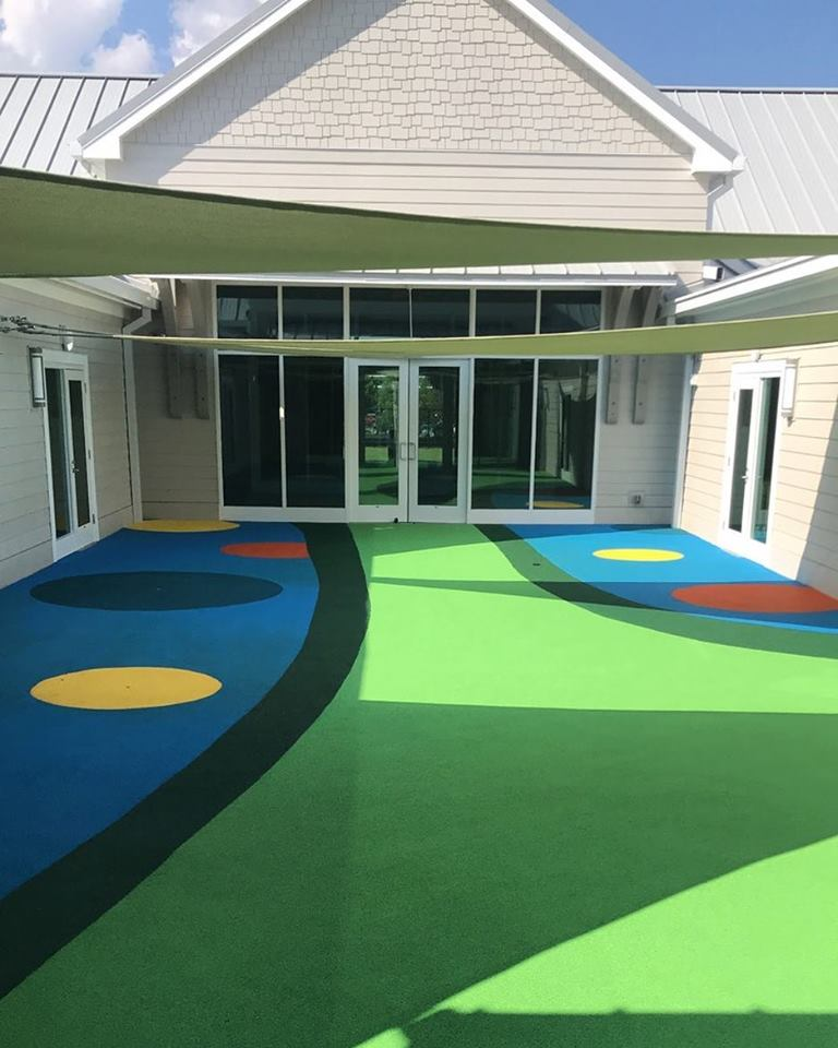 birmingham alabama daycare playground with shades and poured in place rubber safety surfacing 44