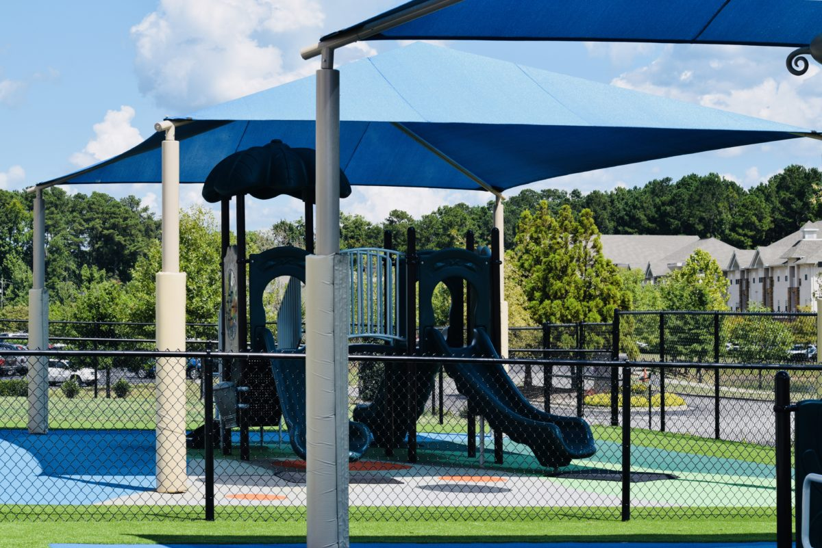 birmingham alabama daycare playground with shades and poured in place rubber safety surfacing 45