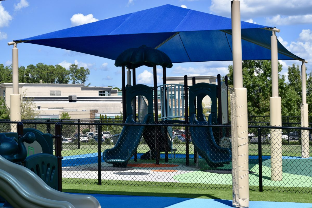 birmingham alabama daycare playground with shades and poured in place rubber safety surfacing 47