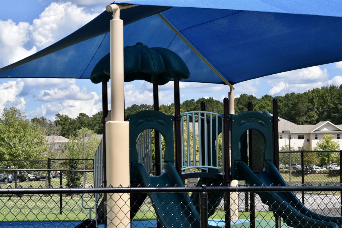 birmingham alabama daycare playground with shades and poured in place rubber safety surfacing 49