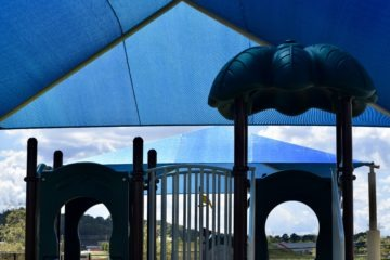 birmingham alabama daycare playground with shades and poured in place rubber safety surfacing 51