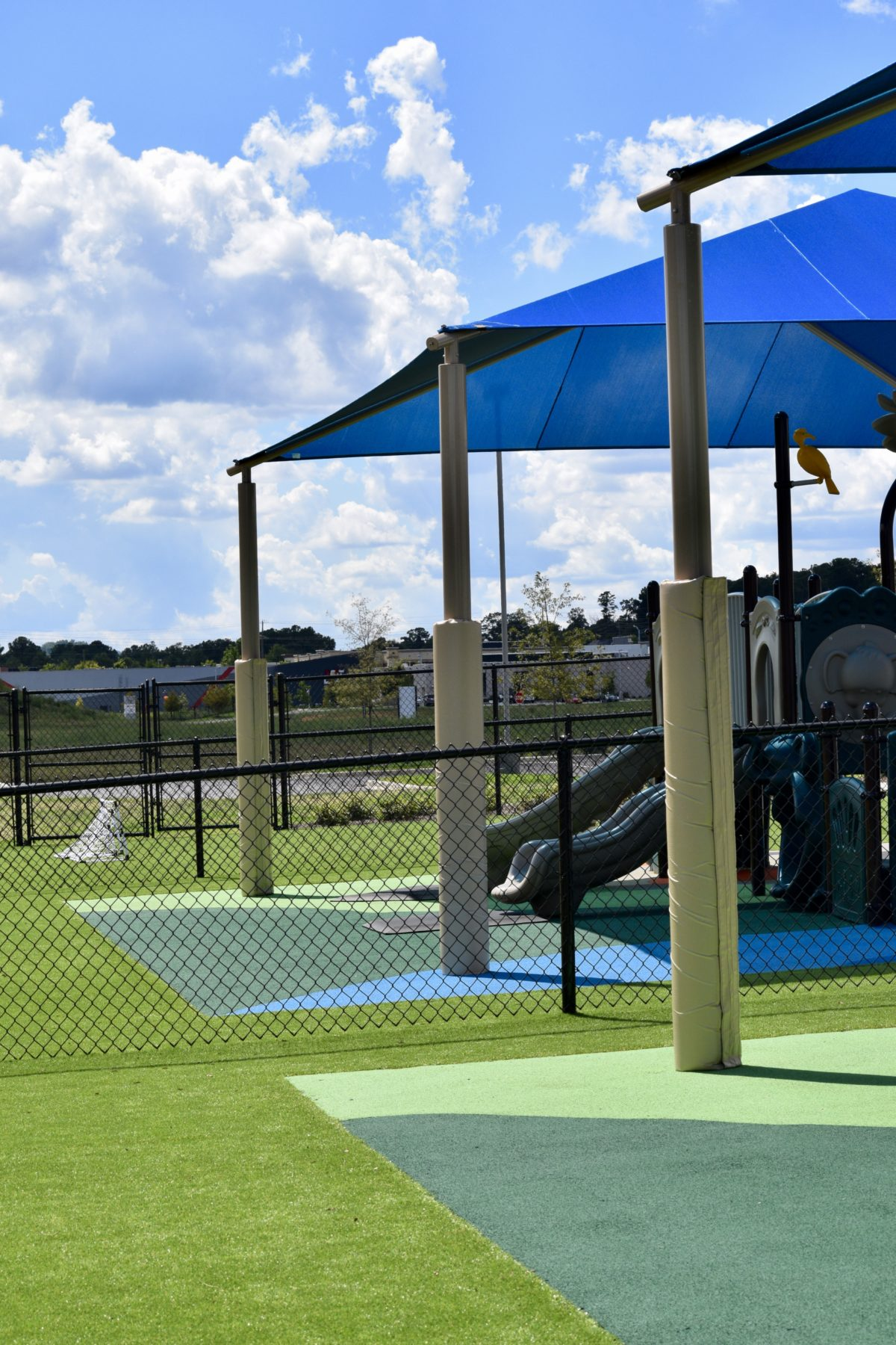 birmingham alabama daycare playground with shades and poured in place rubber safety surfacing 53
