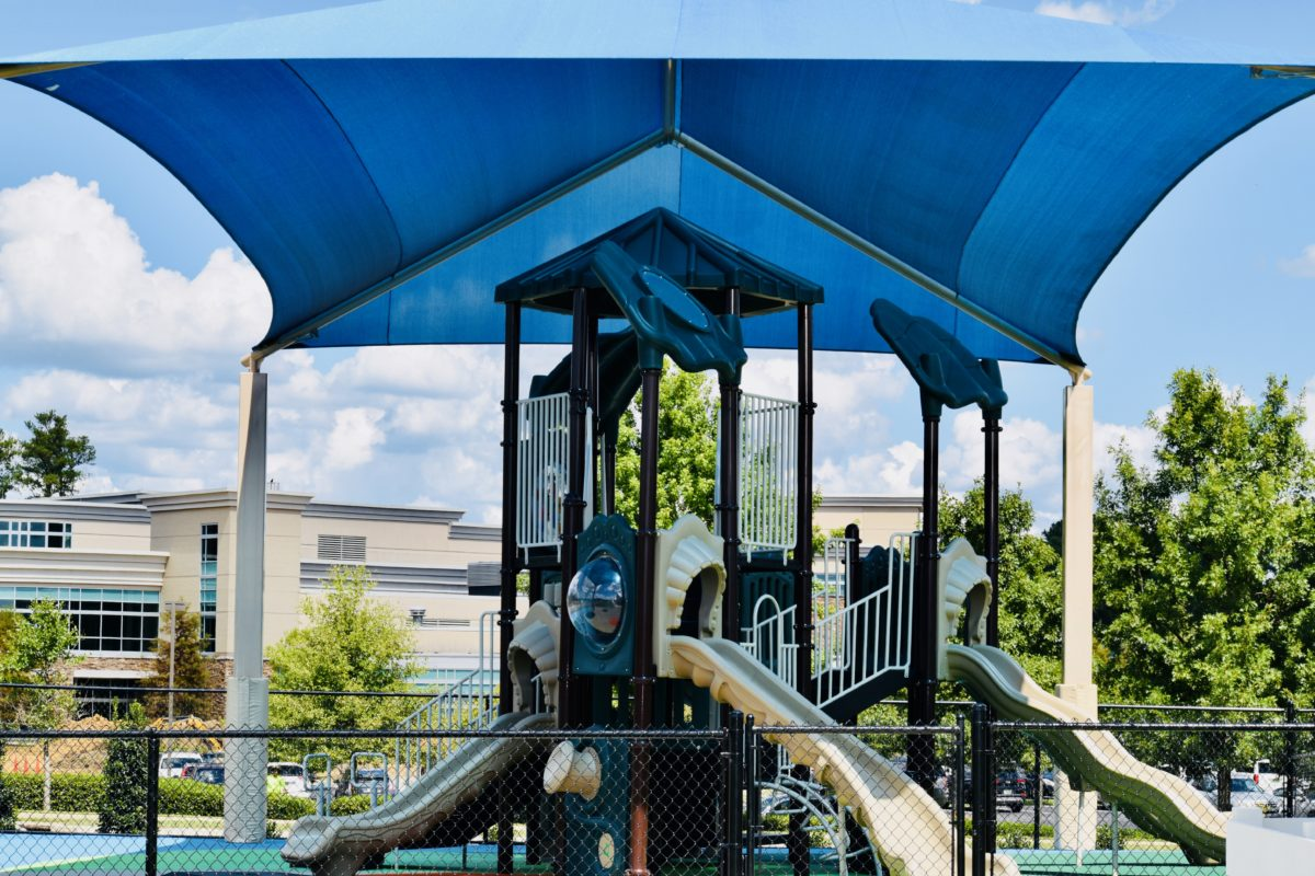 birmingham alabama daycare playground with shades and poured in place rubber safety surfacing 62